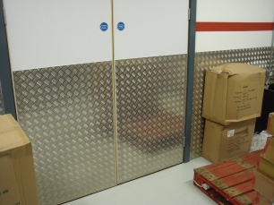Chequer plate in stores to protect walls.