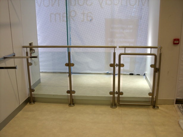 Stainless steel and glass window enclosures.
