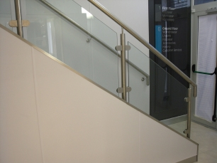 Toughened glass panels at base of escalators and additional customer stairs.