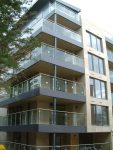 Stainless steel and glass corner balconies and railings, flashing, cladding and soffit.