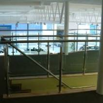 Stainless steel staircase with glass panels.