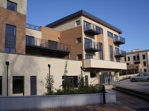 An example of a large balcony, several smaller balconies and railing completed by Gabbett Industries.