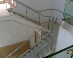 Roof canopy, and internal stainless steel and glass balustrade.