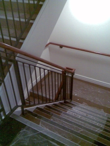 Internal stairs with banister and screw-to-wall handrail.